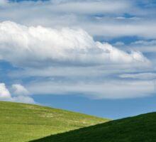 White clouds above green hills Sticker