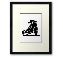 Black ice skate Framed Print