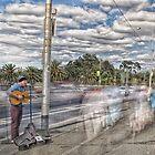 The Busker on The Bridge by JohnKarmouche