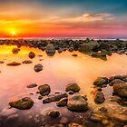 Rockpool sunrise panorama by Ralph Goldsmith