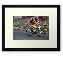 man riding bicycle Framed Print