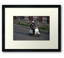 man riding scooter Framed Print