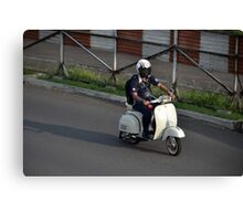 man riding scooter Canvas Print