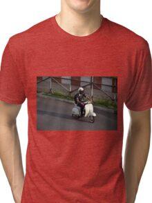 man riding scooter Tri-blend T-Shirt
