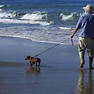 A man and his dog at Pippi Beach by myraj