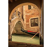 Venice gondola through the arch Photographic Print