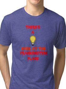 There's a Light (T-Shirt & Sticker) Tri-blend T-Shirt