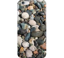 A close up view of smooth polished multicolored stones washed ashore on the beach. iPhone Case/Skin
