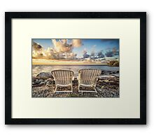 Watching the Sunrise over the ocean Framed Print