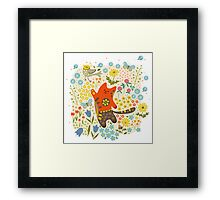 The cat catching a bird. Framed Print
