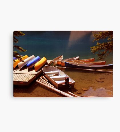 Canoes Docked At Moraine Lake Canvas Print