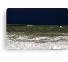 Stormy sea with waves und a dark blue sky. Canvas Print