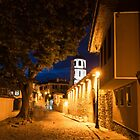 Of Cobblestone Streets and Bell Towers - Yellow Lit Night in Old Town Plovdiv, Bulgaria by Georgia Mizuleva