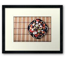 Top view of vegetarian salad in a black plate Framed Print