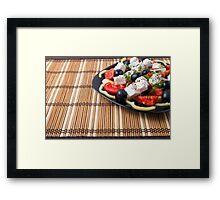 Side view of fresh vegetarian salad on a black square plate Framed Print
