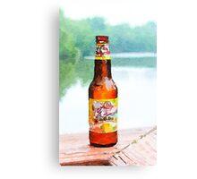 Beer bottle on dock Canvas Print
