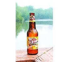 Beer bottle on dock Photographic Print