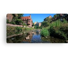 Long Exposure of The Water of Leith with Well Court (Left) & Dean Village (Right) Canvas Print