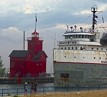 The Manistee and Big Red Lighthouse by Roger  Swieringa