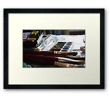 Brushes and colours behind art Framed Print