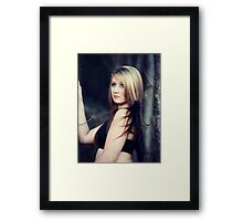 Portrait of blond young woman posing outdoors Framed Print