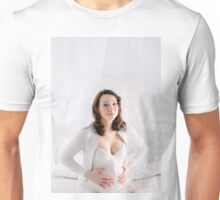 Pregnant Happy smiling Woman sitting on a sofa  Unisex T-Shirt