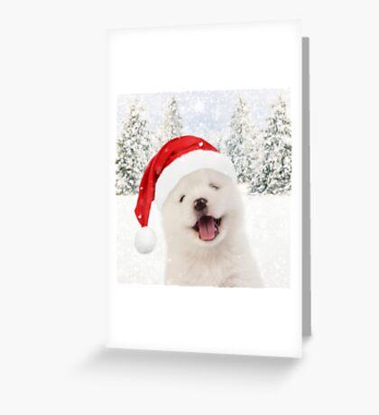 Samoyed puppy wearing Christmas hat Greeting Card
