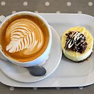 Cappuccino with cheesecake by Arie Koene