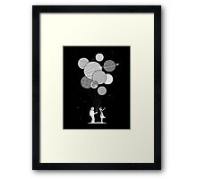 Between planets and balloons. Framed Print