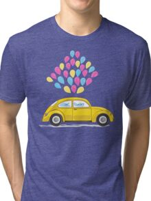 yellow car with colorful balloons on white background Tri-blend T-Shirt
