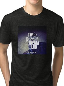 the world is watching Tri-blend T-Shirt