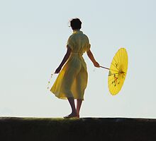 Girl In Yellow on Harbour Wall by Adrian Wale