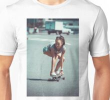 Young woman making downhill with a skateboard Unisex T-Shirt