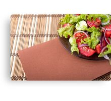 Plate with fresh salad of raw tomatoes and lettuce Canvas Print