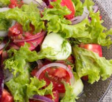 Top view on a plate with fresh salad of raw vegetables Sticker
