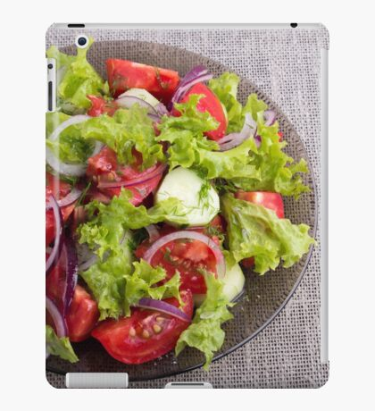 Top view on a plate with fresh salad of raw vegetables iPad Case/Skin