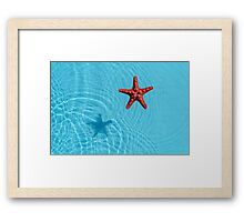 Blue water with starfish Framed Print