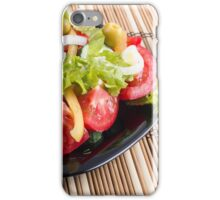 Closeup view fresh natural salad with raw tomato, cucumber, olives iPhone Case/Skin
