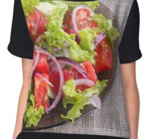 Fragment of a transparent plate with a fresh salad of raw vegetables Chiffon Top