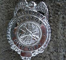 My Dad's fireman badge by James Gibbs