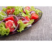 Side view on a diagonal on a plate with fresh salad of raw vegetables closeup Photographic Print