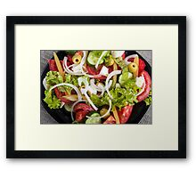 Top view of a plate of salad made from natural raw vegetables Framed Print