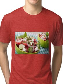 Useful vegetarian salad with raw tomatoes, cucumbers and onions Tri-blend T-Shirt
