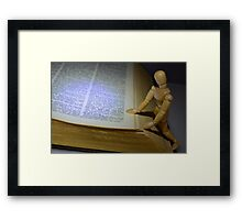Small Wooden Manikin Using A Dictionary Framed Print