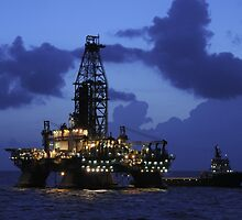 Oil Rig and Vessel at Night by Bradford Martin