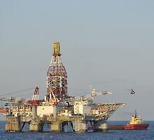 Off Shore Oil Rig with Helicopter and Boat by Bradford Martin