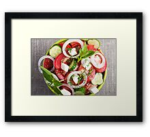 Top view close up on a green bowl with a salad Framed Print