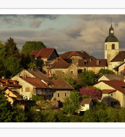 Light and clouds on Chaumont village Sticker