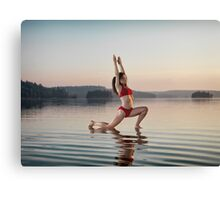 Woman doing Hatha yoga Anjaneyasana Low Lunge pose on the water art photo print Canvas Print