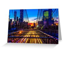 Sunset over the Brooklyn Bridge facing manhattan with lights of passing by cars underneath  Greeting Card